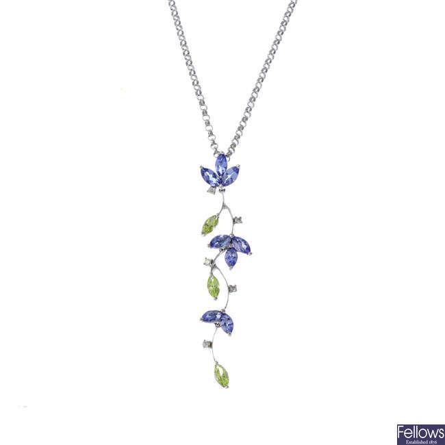 A peridot, tanzanite and diamond pendant, with chain.