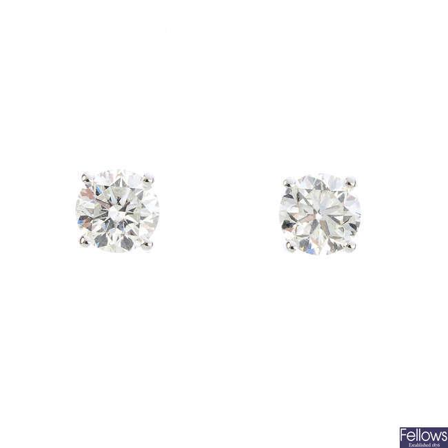 A pair of 18ct gold diamond stud earrings.