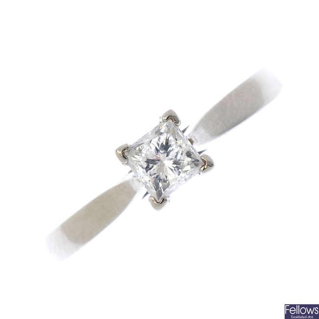 A palladium diamond single-stone ring.