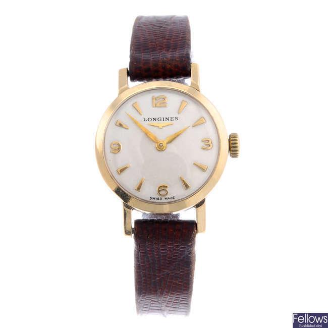 LONGINES - a lady's 9ct yellow gold wrist watch.