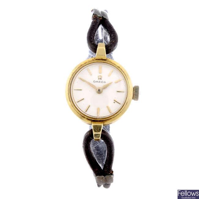 OMEGA - a lady's yellow metal wrist watch with Tudor bracelet watch.