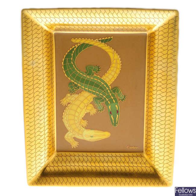 CARTIER - a porcelain crocodile trinket tray.