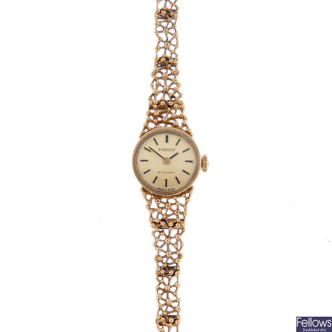 TISSOT - a lady's 9ct yellow gold Stylist bracelet watch.