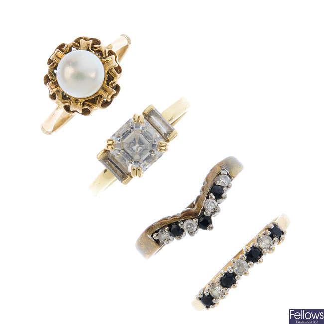 Four gem-set rings.