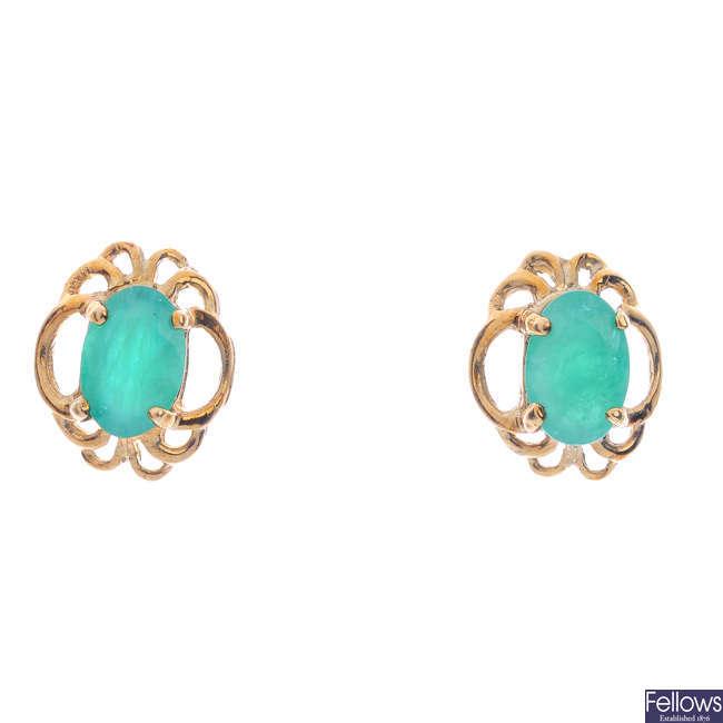 A pair of emerald earrings.
