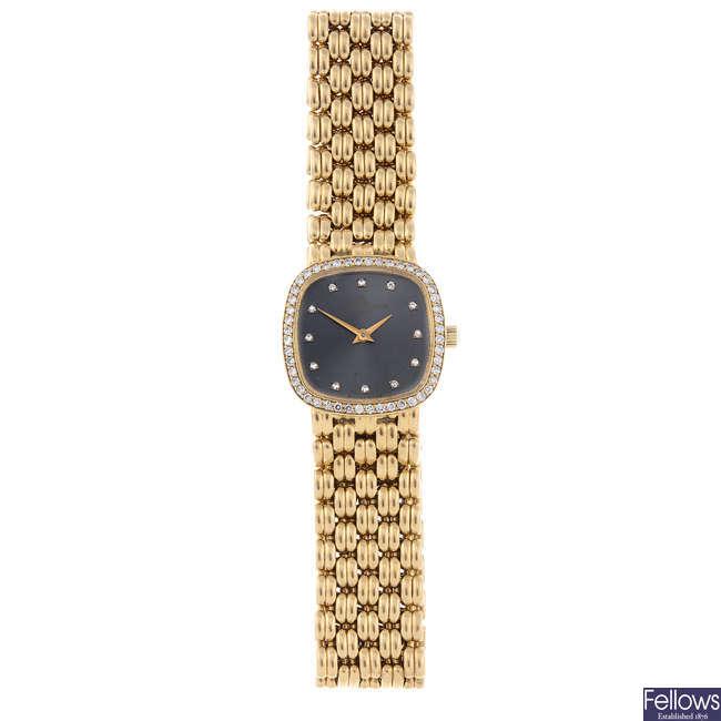 BAUME & MERCIER - a lady's yellow metal bracelet watch.