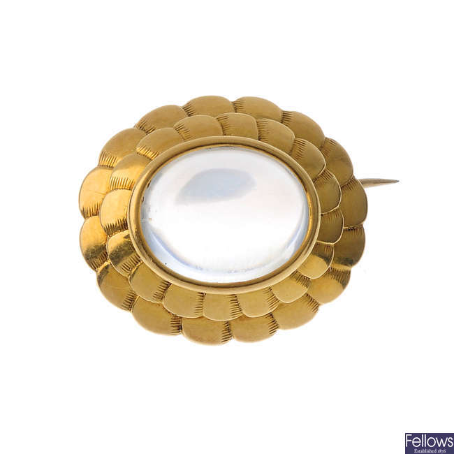 An early 20th century gold, moonstone brooch.