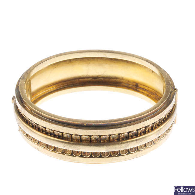 A late Victorian gold hinged bangle.