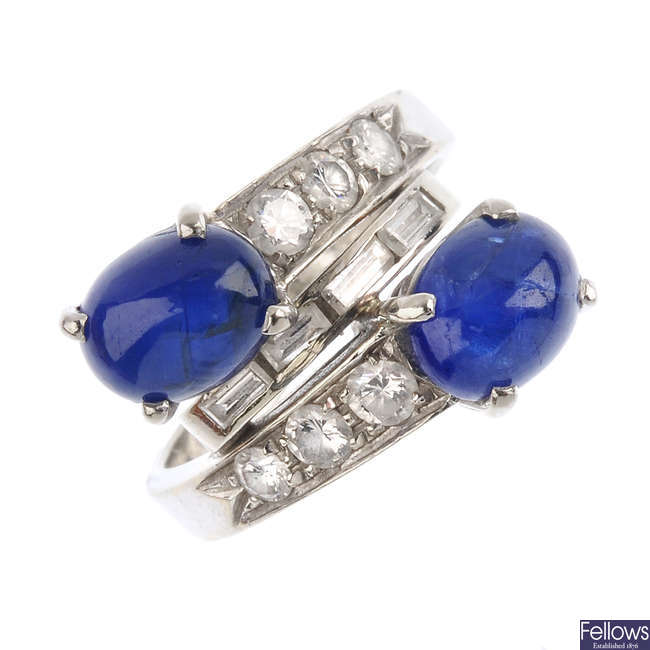 A diamond and sapphire crossover ring.