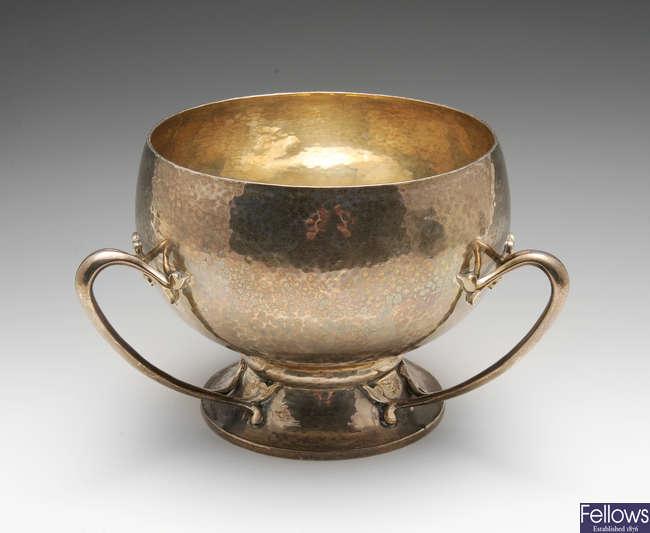 An Edwardian Art Nouveau planished silver bowl.