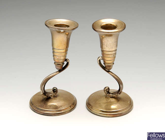 A matched pair of mid-20th century small silver candlesticks.