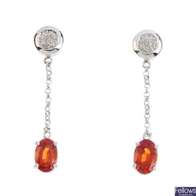 A pair of 9ct gold garnet and diamond earrings.