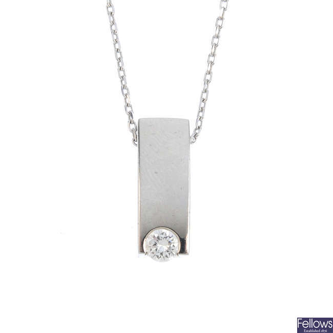 An 18ct gold diamond pendant, with 18ct gold chain.