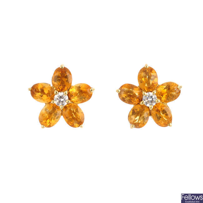 A pair of citrine and diamond cluster earrings.