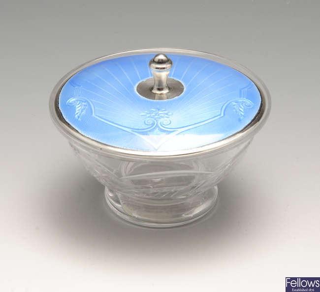 An early twentieth century silver & enamel lidded vanity pot.
