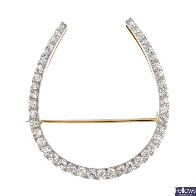 An early 20th century diamond horseshoe brooch.