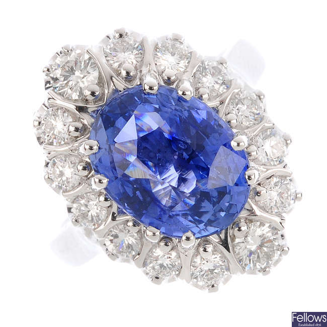 An 18ct gold Ceylon sapphire and diamond cluster ring.