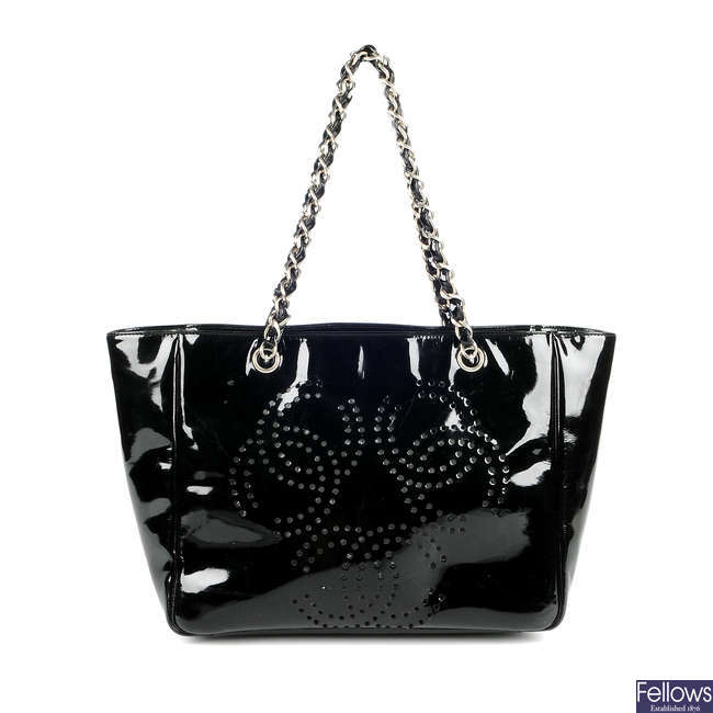 CHANEL - a CC logo perforated patent leather handbag.