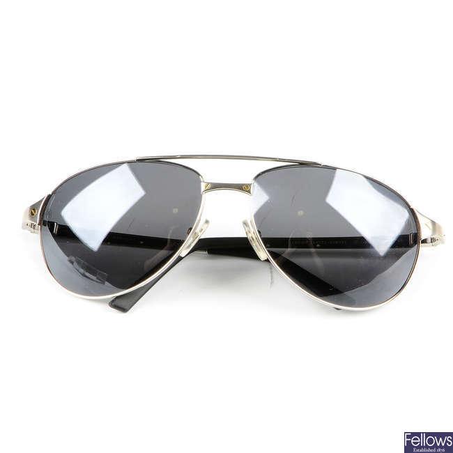 CARTIER - a pair of Santos-Dumont aviator sunglasses.
