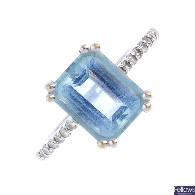 An aquamarine and diamond single-stone ring.