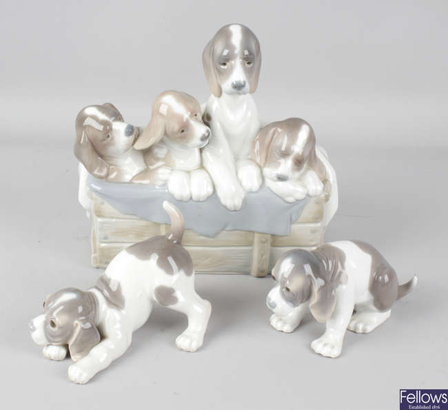 Three Lladro figurines modelled as dogs