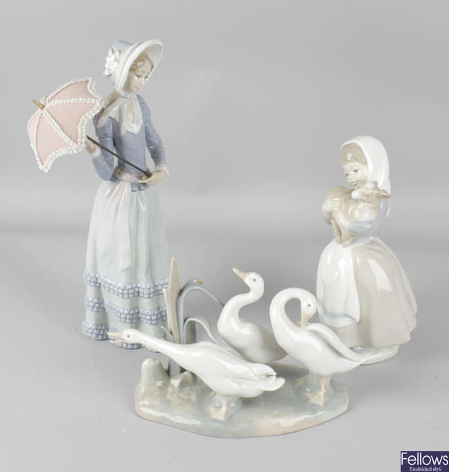 Two Lladro figures and a Nao figure.