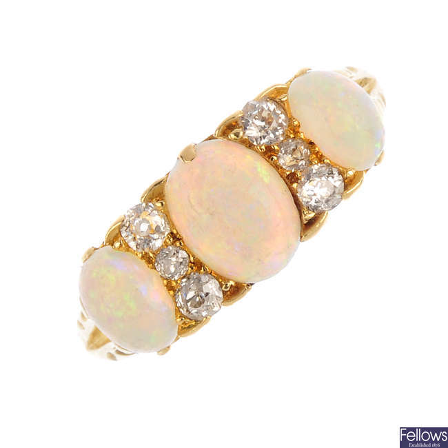 An early 20th century 18ct gold opal three-stone and diamond ring.