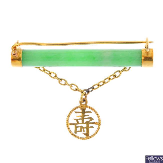 A jade brooch.