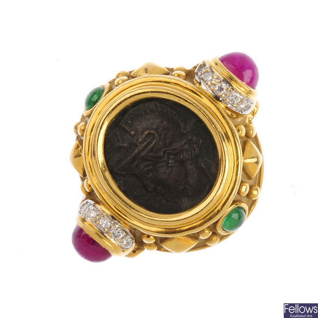 A diamond and gem-set dress ring.