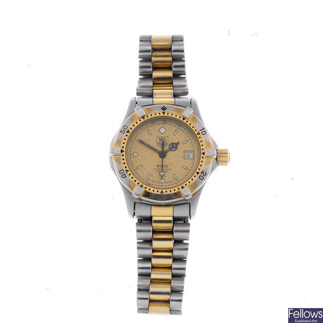 TAG HEUER - a lady's bi-colour 2000 Series bracelet watch.