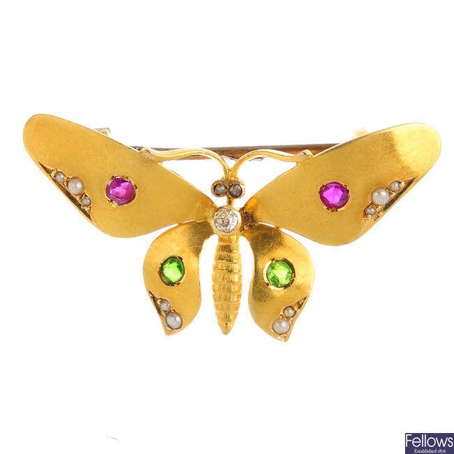 An Edwardian gold diamond and gem-set butterfly brooch.