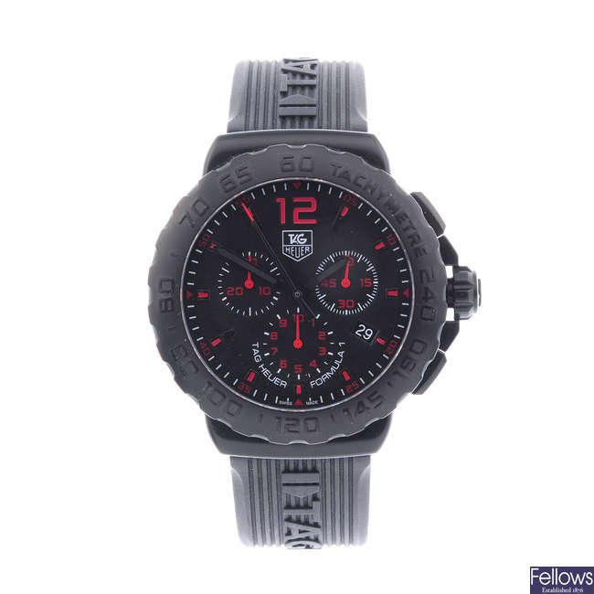 TAG HEUER - a gentleman's PVD-treated stainless steel Formula 1 chronograph wrist watch.