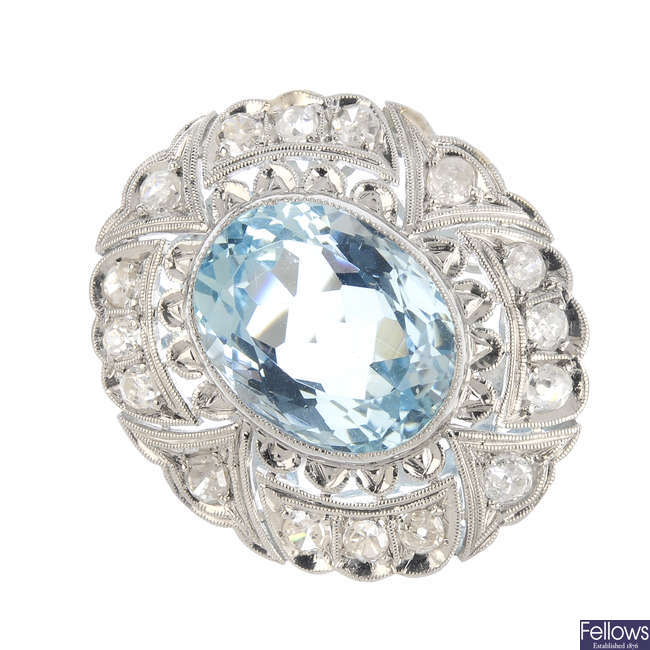 An early 20th century aquamarine and diamond dress ring.