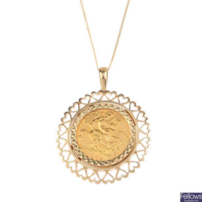A half sovereign pendant