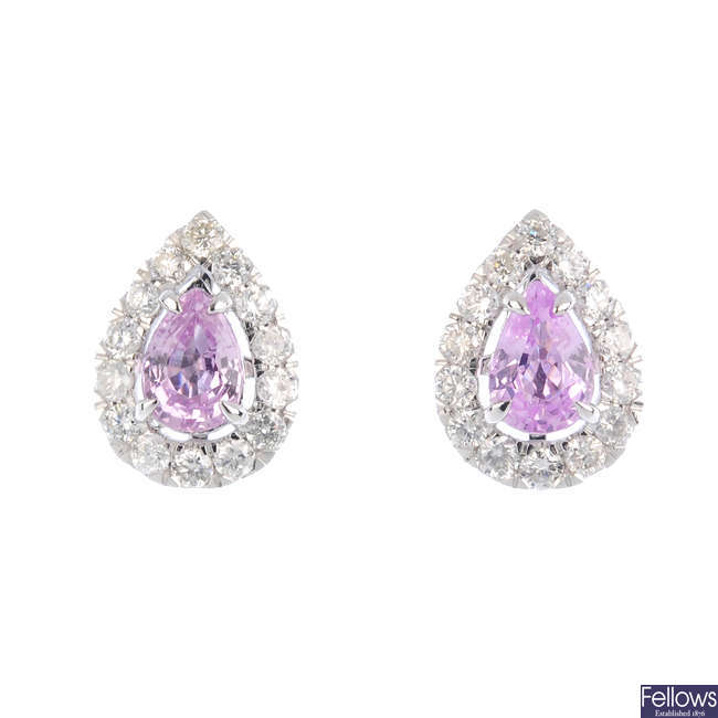A pair of pink sapphire and diamond cluster earrings.