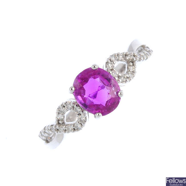 A pink sapphire and diamond dress ring.