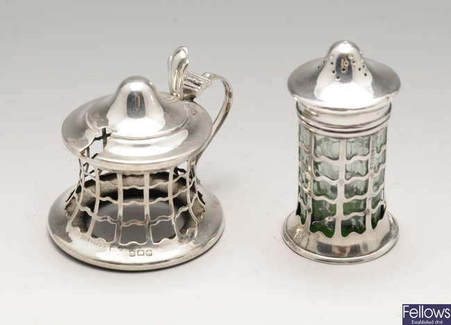 An Edwardian silver mustard pot and caster & three early twentieth century silver mustard pots. (5).
