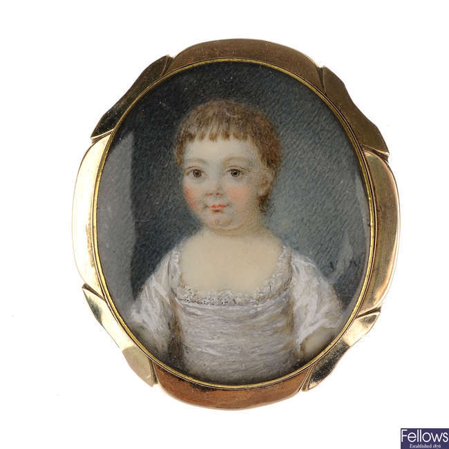 A mid Victorian portrait gold brooch.