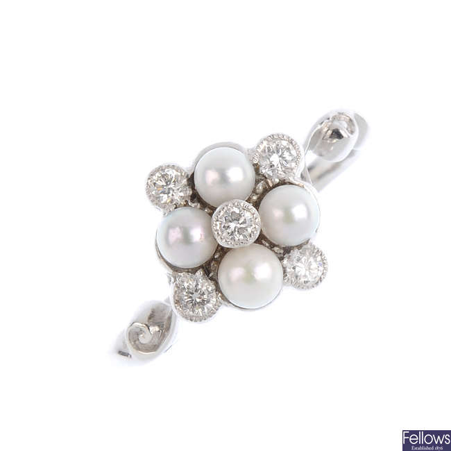 A diamond and cultured pearl dress ring.