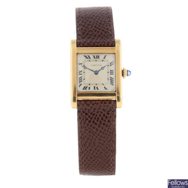 CARTIER - a yellow metal Tank wrist watch.