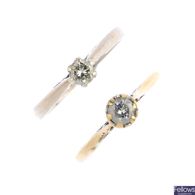 Two gold diamond single-stone rings.