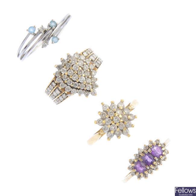 Four diamond and gem-set dress rings.