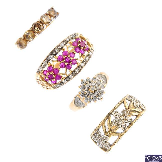 Four 9ct gold diamond and gem-set dress rings.