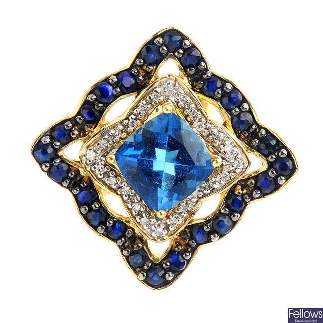 A 9ct gold diamond and gem-set dress ring.