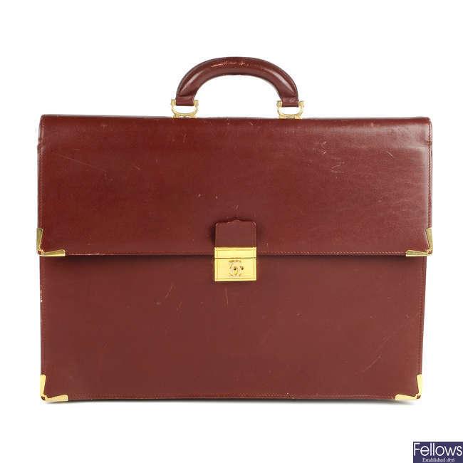 CARTIER - a Must De Cartier Bordeaux leather briefcase.