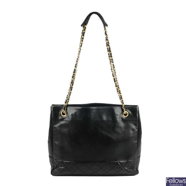 CHANEL - a vintage black lambskin leather partially quilted handbag.