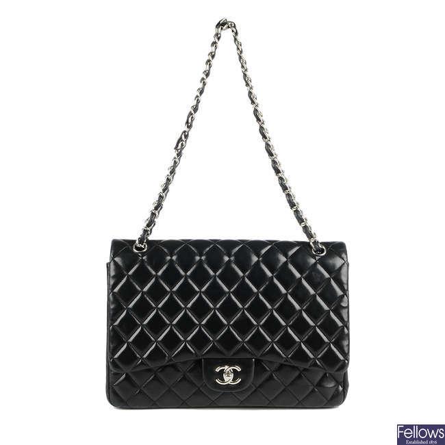 CHANEL - a Maxi Classic Flap handbag.