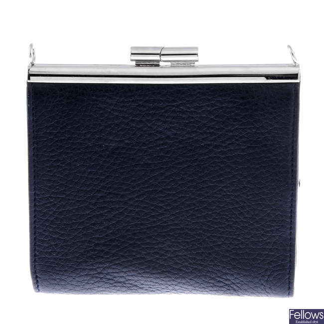 BULGARI - a small leather purse with chain.