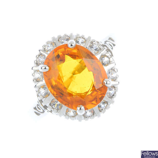 An 18ct gold orange sapphire and diamond ring.