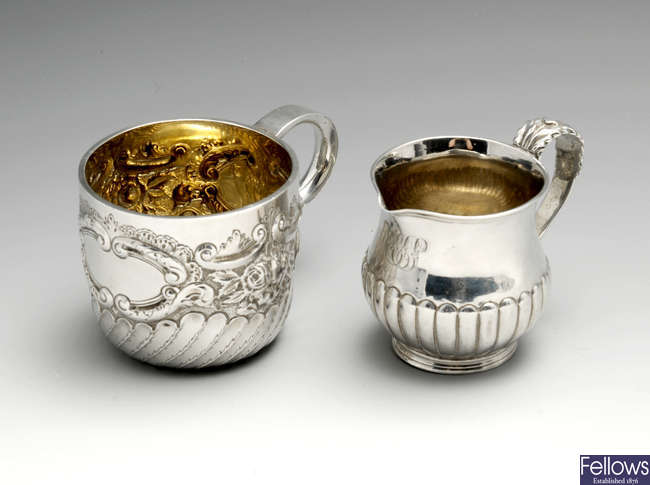 A George IV silver cream jug & a late Victorian example. (2).